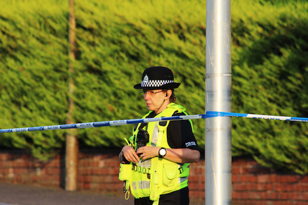 Investigation launched after dead body found in school playing fields