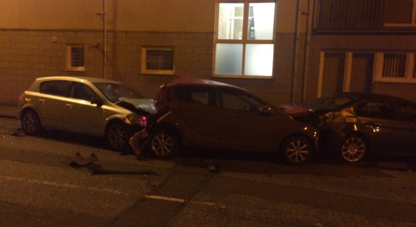 VIDEO: Driver arrested after early morning collision with parked cars
