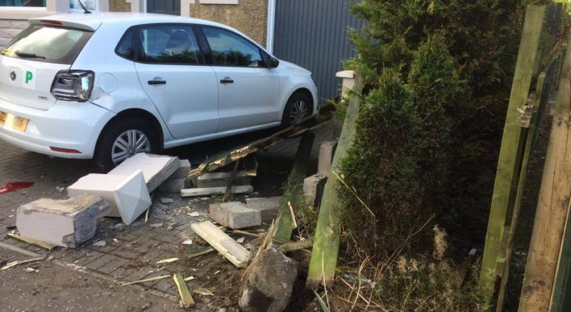 Police hunt driver after car smashes through garden