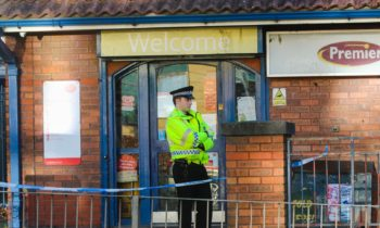 Police stand guard at Sandys Post Office in Granton.