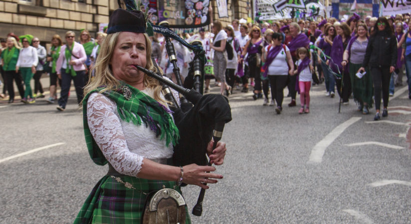 Thousands take part in parade to mark suffrage centenary
